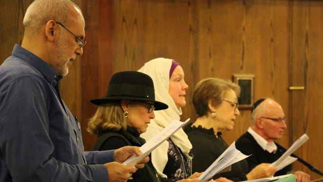 Addressing attendees at the Unity Vigil are (from left): Yasser Abdelkader, president of the Al Falah Islamic Center; Sisterhood of Salaam Shalom Raritan Valley chapter members Nancy Gorrell, Pamela D'Amato and Leora Isaacs; and Temple Sholom Rabbi Emeritus Ron Isaacs.