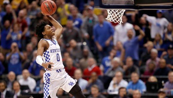 Kentucky's De'Aaron Fox heads to the basket during