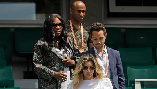Serena Williams, left, leaves after watching her sister Venus Williams' match against Japan's Kurumi Nara during the French Open on May 31.