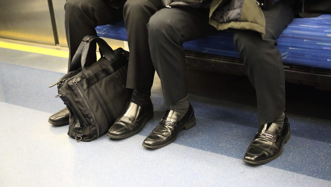 Manspreading is when a man spreads his legs in others' spaces while sitting.