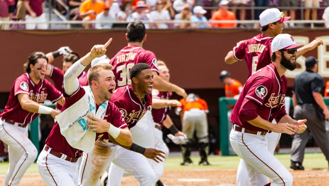 The Florida State baseball team celebrates after a 7-6 walk-off victory over Sam Houston State in the Tallahassee Super Regionals on Saturday at Dick Howser Stadium.