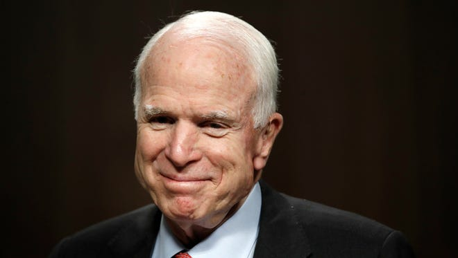 Senate Armed Services Committee Chairman Sen. John McCain, R-Ariz., arrives on Capitol Hill in Washington, Tuesday, July 11, 2017, for the committee's confirmation hearing for Navy Secretary nominee Richard Spencer.
