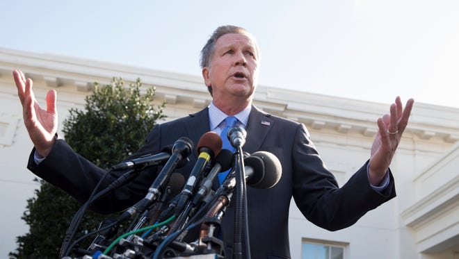 Ohio Gov. John Kasich responds to questions from members of the news media following his meeting with President Trump, outside the West Wing of the White House in Washington, D.C, February 24, 2017.