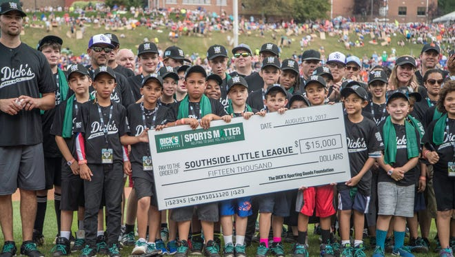 Southside Little League players and coaches display the check presented to the organization by Dick's Sporting Goods while the team was treated to games at the Little League World Series.