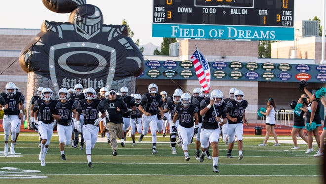 The Onate Knight football team takes the field during the Onate homecoming game against Atrisco Heritage Academy on September 1, 2017.