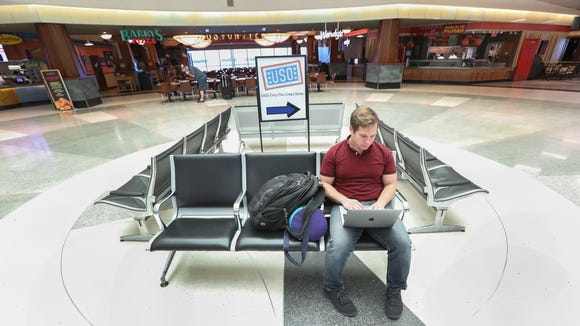 Tyler Franz of Charlotte waits for his flight at a