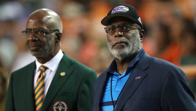 MEAC Commissioner Devin Thomas stands next to FAMU Interim President Larry Robinson before their game against NC Central Thursday night game at Bragg Memorial Stadium.