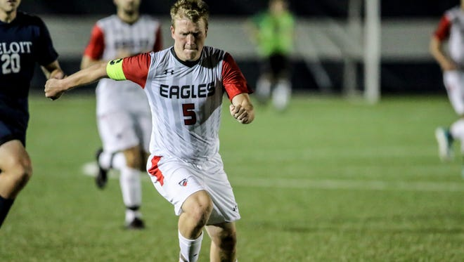Garrett Lee dribbles up the field for the Edgewood College soccer team.