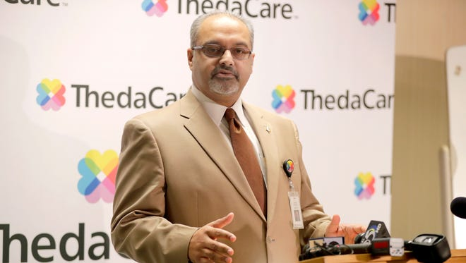 Dr. Imran Adrabi, president and CEO of ThedaCare, talks to the press on Wednesday following the announcement that the organization will not be consolidating its hospitals.