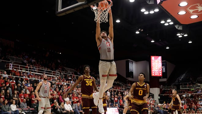 Stanford guard Dorian Pickens (11) dunks against Arizona State during the second half of an NCAA college basketball game Wednesday, Jan. 17, 2018, in Stanford, Calif.
