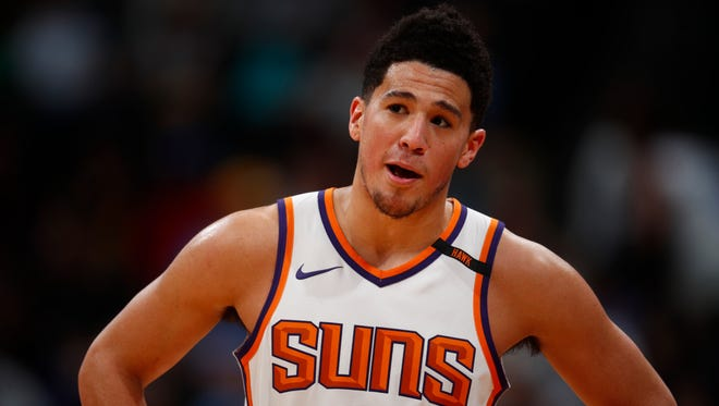 Phoenix Suns guard Devin Booker (1) in the second half of an NBA basketball game Friday, Jan. 19, 2018, in Denver. Phoenix won 108-100.
