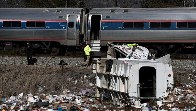 Emergency personnel work at the scene of a train crash involving a garbage truck in Crozet, Va., on Wednesday, Jan. 31, 2018. An Amtrak passenger train carrying dozens of GOP lawmakers to a Republican retreat in West Virginia struck a garbage truck south of Charlottesville, Va. No lawmakers were believed injured, but it at least one person in the truck was said to be seriously injured.