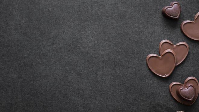 Chocolate hearts on the dark table