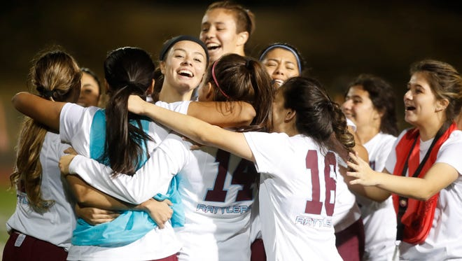 Rancho Mirage High School's players celebrate win against Coachella Valley High School on February 7, 2018 during their match in Rancho Mirage to determine best De Anza League recored. The Rattlers won 3-2.