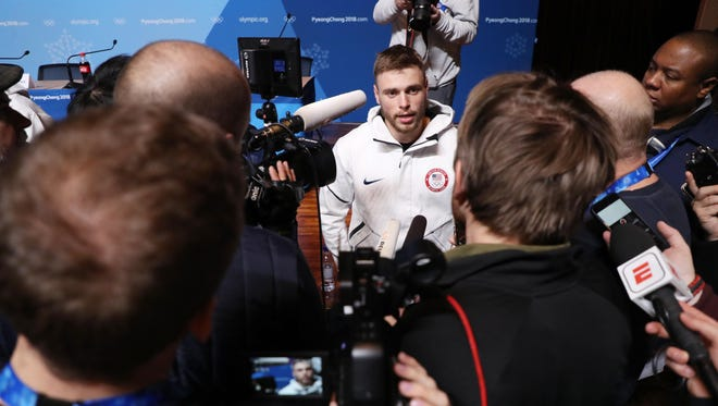 Gus Kenworthy answers questions during the slopestyle skiing news conference..