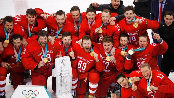 Olympic athletes from Russia celebrate after winning the men's gold medal hockey game against Germany.