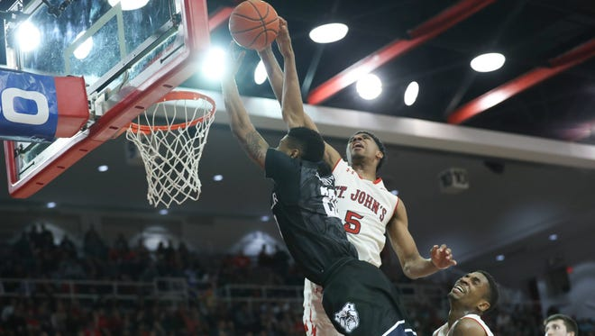 St. John's Red Storm guard Justin Simon (5) takes Butler Bulldogs guard Henry Baddley (20) off the basket during the first half at Carnesecca Arena.
