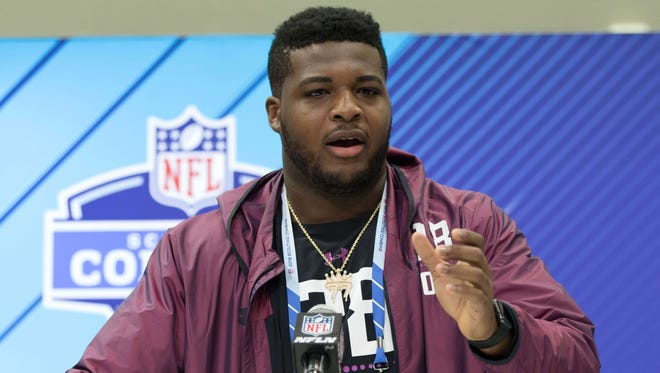 Western Michigan Broncos offensive lineman Chuks Okorafor speaks to the media during the 2018 NFL Combine at the Indianapolis Convention Center on Thursday March 1, 2018 in Indianapolis, Ind.