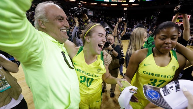 Oregon's Sabrina Ionescu (20) celebrates with her dad, Dan Ionescu, after the team beat Stanford in an NCAA college basketball game in the finals of the Pac-12 Conference women's tournament, Sunday, March 4, 2018, in Seattle. Oregon won 77-57.