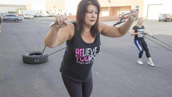 Kimberly Flowers works out  with other women at Iron Girlz fitness studio in Peoria that offers women of all ages and fitness levels physical and emotional support to reach their goals.