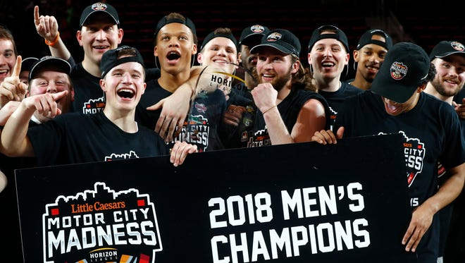 Wright State players celebrate their win over Cleveland State in the Horizon League men's championship game in 2018.