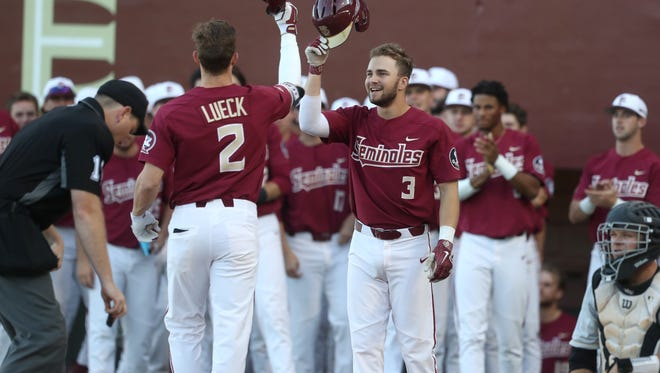 FSU's Nick Derr congratulates Jackson Lueck after his 2-run home run against UCF helping the Seminoles to a 6-4 win at Dick Howser Stadium on Tuesday, March 20, 2018.