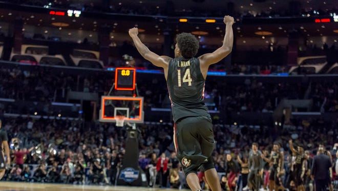 FSU junior Terance Mann celebrates the Seminoles Sweet 16 win over Gonzaga. He led the team with 18 points.