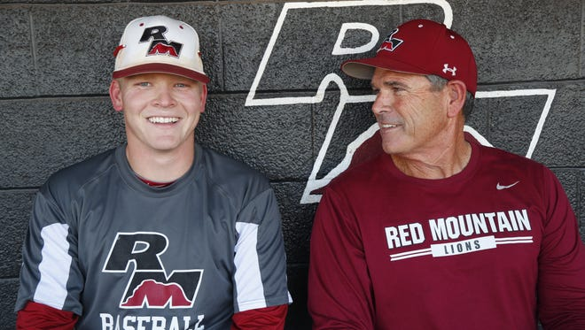 Riley Pagel with his father and head coach Ross Pagel in the dugout at Red Mountain High School in Mesa, Ariz. on April 9, 2018. Riley was diagnosed with Type 1 diabetes when he was 5-years-old, but still plays both baseball and football at the school.
