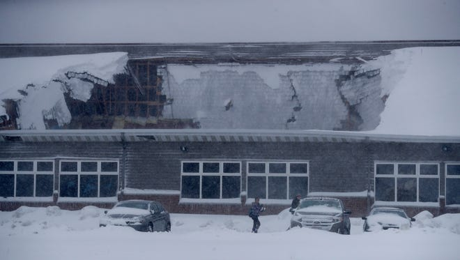 Heavy snow caused a partial collapse of the roof Sunday morning at the Econo Lodge hotel in Ashwaubenon.