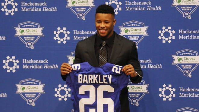 First round draft pick for the New York Giants, Saquon Barkley being introduced before he answered questions from the press.