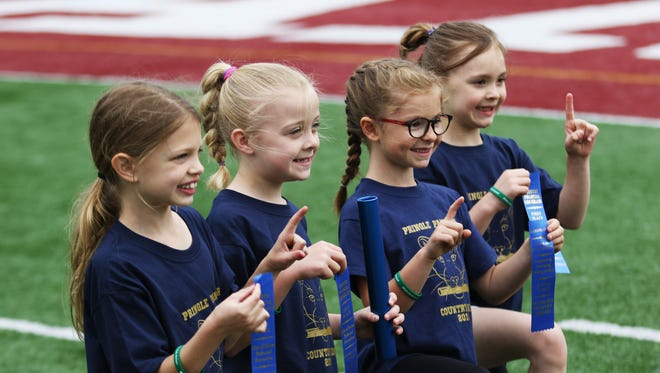 Pringle Elementary School's first-grade girls team poses with their ribbions after their race at the 44th Annual COUNTRY Kids Relay at Willamette University's McCulloch Stadium on Saturday, May 19, 2018.