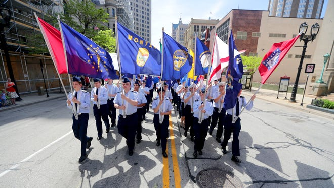 Members of the Greenfield Air Force Junior ROTC carry all 50 state flags while marching on Wisconsin Avenue in Milwaukee's 153rd annual Memorial Day Parade.
