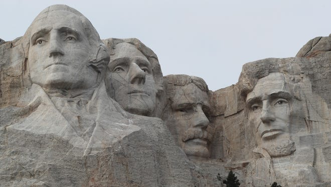 In this Dec. 9, 2016, file photo, the faces of the presidents that make up the Mount Rushmore monument are shown near Keystone, S.D.