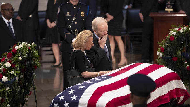 Sen. Joe Lieberman, right, and his wife Hadassah Lieberman, pay their respects at the flag-draped casket of Sen. John McCain of Arizona, who lived and worked in Congress over four decades, in the U.S. Capitol rotunda, Friday, Aug. 31, 2018, in Washington.