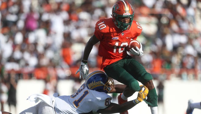 FAMU's Orlando McKinley leaps over Fort Valley State University's Kei'Jne Thomas after intercepting a pass. McKinley is currently prepping for his Pro Day scheduled for late March.
