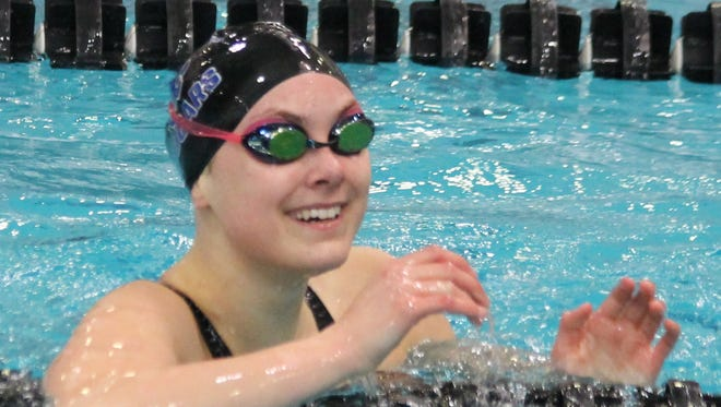 Payton Keiner smiles after   looking at her time and seeing she was the state champion in the 100 backstroke.
