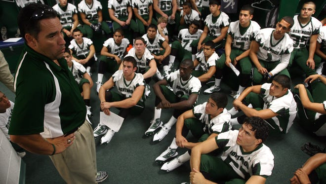 Montwood head coach Chuck Veliz addresses one of his former teams. Veliz announced his retirement on Wednesday.