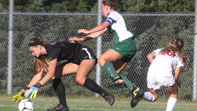 North Rockland goalie Jenna Braunagel gets to the ball before Yorktown's Alyssa Francese, center, during their game at North Rockland Sept. 27, 2016. North Rockland won 2-1.