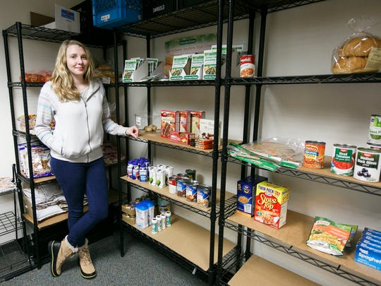 """Rebecca Hardgrave, Director of the Hungry Like the Wolf food pantry at Western Oregon University, stands with shelves of goods in the pantry on Wednesday, Nov. 20, 2016. """"The struggle this year is keeping food on the shelves,"""" Hardgrave says, noting that by Wednesday a lot of the food for the week is already gone."""