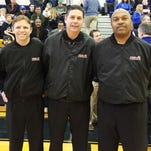 Bob Czech (center) has been officiating for more than 30 years and heads the Metro Detroit Athletic Officials group. Working on his crew at a recent basketball game are Plymouth's Paul Woodard (left) and Southfield's Darcy Gitchuway.
