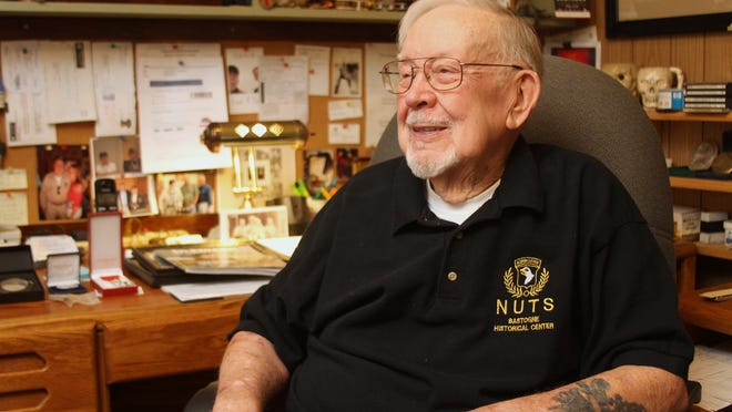Author and veteran Don Burgett, shown in the study of his Marion Township home, is re-issuing his novels for sale on Amazon.