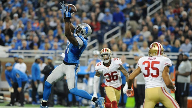 Detroit Lions wide receiver Calvin Johnson misplays a catch defended by San Francisco 49ers cornerback Dontae Johnson (36) and free safety Eric Reid (35) during the first half of an NFL football game, Sunday, Dec. 27, 2015, in Detroit. (AP Photo/Jose Juarez)