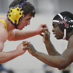Dominic Latona, Thompson High, right, and Brandon Cunningham, Prattville High, participate in the Barry Mask Wrestling Tournament at Cramton Bowl on Jan. 25.