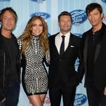 """""""American Idol"""" judges this season are Keith Urban (from left, Jennifer Lopez and Harry Connick Jr. (far right), who pose with Ryan Seacrest."""