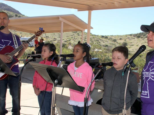 Youth singers, under the direction of Rayn and Crystal Gonzales, performed during Saturday's mass at Rockhound State Park.