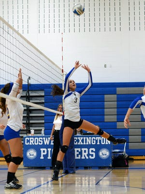 Pioneers Rachel Soper sets up a hit Monday, Nov. 2, during district volleyball at Cros-Lex.