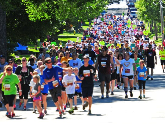 Runners and walkers take the turn on South Clay and
