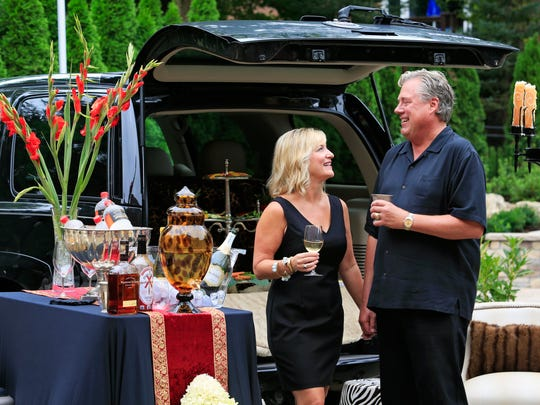 Lori and Tim Laird with a fancy set-up for tailgating. August 7, 2015