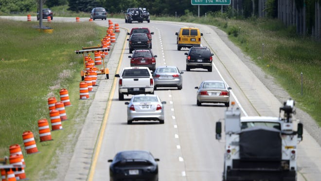 Motorists travel toward Calumet Street on Highway 441 on June 23 in Appleton. This section of road was closed June 18 because of road buckling.