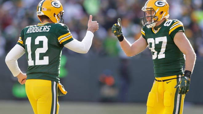 The Green Bay Packers' Aaron Rodgers and Jordy Nelson celebrate their touchdown connection in the second quarter.